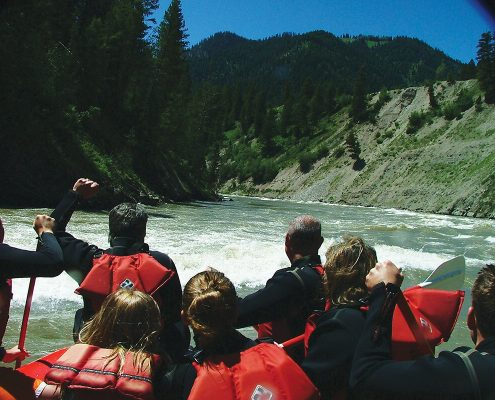 The Snake River rapids and people rafting