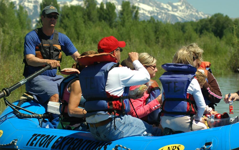 Taking photos on a scenic float trip on Snake River