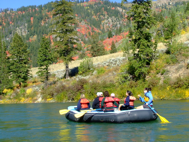 group of people taking scenic float trip in Fall in Jackson Hole